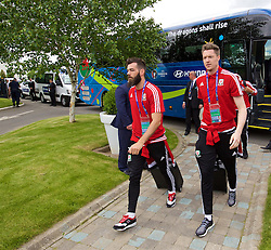 LILLE, FRANCE - Wednesday, June 15, 2016: Wales' Joe Ledley and goalkeeper Wayne Hennessey arrive at the team hotel, the Novotel Lens Noyelles, ahead of their Group Stage MD 2 game of the UEFA Euro 2016 Championship against England. (Pic by David Rawcliffe/Propaganda)