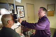 Owner Raymond Pedersen, OD, examines Fremont resident Rick Reisinger's eyes at Capitol Eye Care Center in Fremont, California, on April 10, 2014. Pedersen has been in business since 1987. (Stan Olszewski/SOSKIphoto)