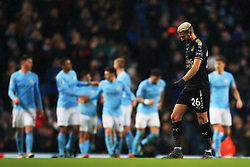 Riyad Mahrez of Leicester City looks dejected as Manchester City players celebrate - Mandatory by-line: Matt McNulty/JMP - 10/02/2018 - FOOTBALL - Etihad Stadium - Manchester, England - Manchester City v Leicester City - Premier League