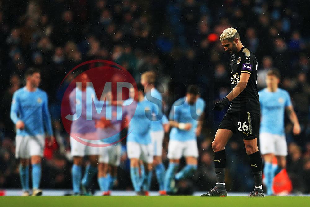 Riyad Mahrez of Leicester City looks dejected as Manchester City players celebrate - Mandatory by-line: Matt McNulty/JMP - 10/02/2018 - FOOTBALL - Etihad Stadium - Manchester, England - Manchester City v Leicester City - Premier League