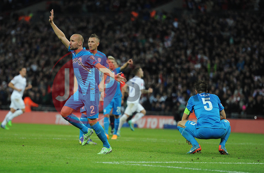 Miso Brecko of Slovenia runs to the lines as he claims Danny Welbeck of England (Arsenal) goal is offside. - Photo mandatory by-line: Alex James/JMP - Mobile: 07966 386802 - 15/11/2014 - SPORT - Football - London - Wembley - England v Slovenia - EURO 2016 Qualifier