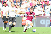 West Ham United midfielder Mark Noble (16) battles with Manchester United Defender Luke Shaw during the Premier League match between West Ham United and Manchester United at the London Stadium, London, England on 29 September 2018.