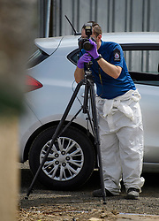 © Licensed to London News Pictures. 16/05/2017. London, UK. Members of a police search team uses a camera as the search continues for the body of murdered schoolgirl Danielle Jones at a block of garages in Stifford Clays in Thurrock, Essex. The 15-year-old was last seen on Monday June 18 2001 at about 8am when she left her home in East Tilbury to catch the bus to school.  Photo credit: Ben Cawthra/LNP
