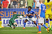 Peterborough no 9 Shaquile Coulthirst battles for the ball with West Ham goalkeeper Rob Green in the  Friendly match between Peterborough United and Leeds United at London Road, Peterborough, England on 23 July 2016. Photo by Nigel Cole.