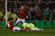 Nottingham Forest midfielder Chris Cohen (8)  fouls Brighton winger, Jamie Murphy (15)  during the Sky Bet Championship match between Nottingham Forest and Brighton and Hove Albion at the City Ground, Nottingham, England on 11 April 2016. Photo by Simon Davies.