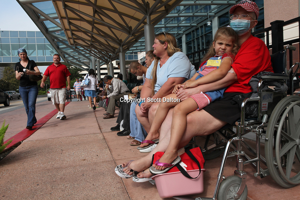 Patients and family members wait for rides outside the MD Anderson Cancer Center in Houston, TX on October 5, 2009. (Photo/Scott Dalton)