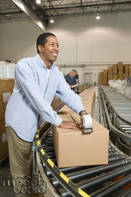 Cheerful man working in distribution warehouse