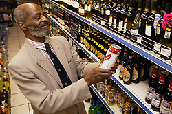 Man at his local shop; East Midlands Supermarket; Nottingham,