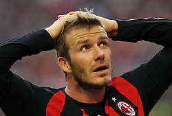 AC Milan midfielder David Beckham reacts during the Serie A football match against Atalanta at the San Siro Stadium in Milan on March 8, 2009.