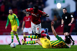 Famara Diedhiou of Bristol City is tackled by Ahmed Hegazy of West Bromwich Albion - Mandatory by-line: Ryan Hiscott/JMP - 22/02/2020 - FOOTBALL - Ashton Gate - Bristol, England - Bristol City v West Bromwich Albion - Sky Bet Championship