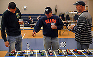 26 FEB. 2011 -- ST. LOUIS -- Pinewood derby racers Leslie Granadillo (center) compares notes with Mark Meyers (left) and Rob Willett about their cars before the first race of the Adult Pinewood Derby sponsored by the Men's Club at Our Lady of Sorrows Catholic Church in St. Louis Saturday, Feb. 26, 2011. Proceeds from the event went to support Boy Scouts of America. Granadillo was a division winner during the evening.  Image copyright © 2011 Sid Hastings.