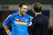 Mark Tyler of Luton Town enjoys a joke with the referee during the The FA Cup match at Kenilworth Road, Luton<br /> Picture by David Horn/Focus Images Ltd +44 7545 970036<br /> 16/12/2014