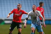 Brighton & Hove Albion full back Liam Rosenior (23)  marks Coventry City forward Stuart Beavon (16)  during the EFL Trophy match between Coventry City and Brighton and Hove Albion at the Ricoh Arena, Coventry, England on 10 January 2017. Photo by Simon Davies.