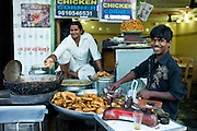 Food on sale at Chicken Corner in Snack market at muslim Meena Bazar, in Old Delhi, India