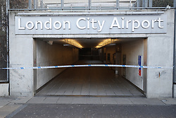 © Licensed to London News Pictures. 12/02/2018. London, UK. London City Airport remains closed after a World War II era bomb was found in The River Thames during routine work on nearby King V Dock. Police have evacuated nearby residents, closed the airport and set up a 214-metre exclusion zone. Photo credit: Peter Macdiarmid/LNP