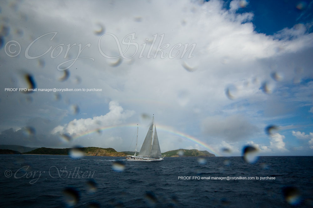 Timoneer racing at the Superyacht Cup Regatta with a rainbow in the background.