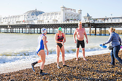 © Licensed to London News Pictures. 05/11/2017. Brighton, UK. Members of the Brighton Swimming Club brave the cold water and powerful waves to go for a swim in the sea in Brighton and Hove. Photo credit: Hugo Michiels/LNP