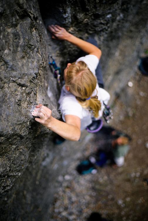 Nancy McCullough climbing Merciless Onslaught, 5.12b, American Fork Canyon, Utah