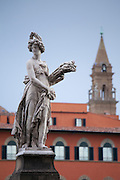 Classical Florentine marble statue on the corner of Lungarno Corsini and Ponte San Trinita in Florence,Tuscany, Italy RESERVED USE - NOT FOR DOWNLOAD - FOR USE CONTACT TIM GRAHAM
