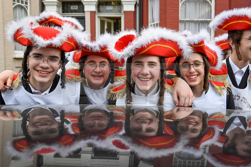© Licensed to London News Pictures. 21/03/2019. LONDON, UK.  Boys from a Jewish study group in Stamford Hill, north London, dress in colourful costumes as they celebrate the Jewish festival of Purim.  The festival involves the reading of the Book of Esther, describing the defeat of Haman, the Persian king's adviser, who plotted to massacre the Jewish people 2,500 years ago, an event that was prevented by Esther's courage.  Photo credit: Stephen Chung/LNP