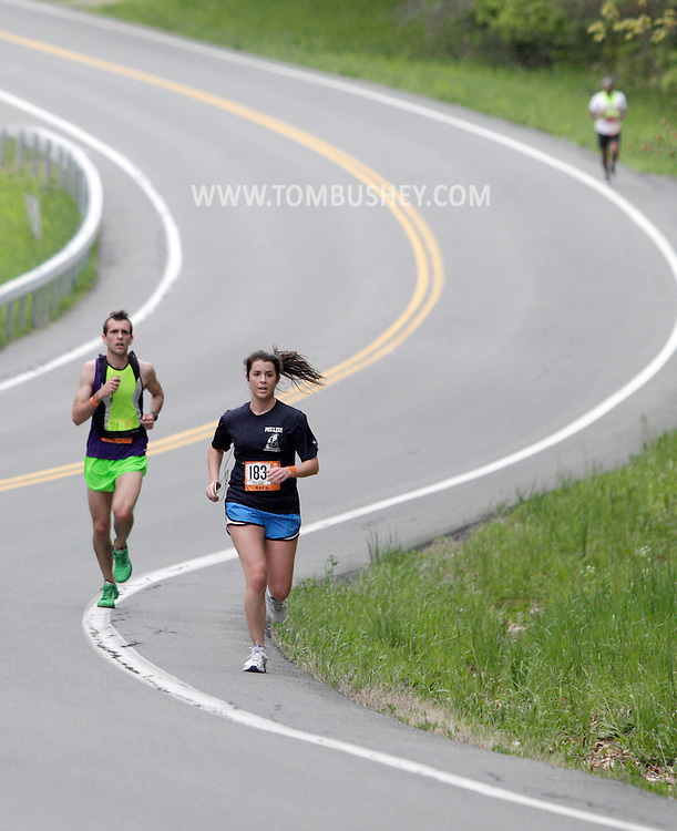 Runners head up a hill on the ninth leg of the Ragnar Relay in the Town of Crawford on Friday, May 14, 2011.