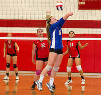 Gilford's Shannon Mercer bumps the ball during Wednesday night NHIAA Division II Volleyball action with Laconia High School.  (Karen Bobotas/for the Laconia Daily Sun)