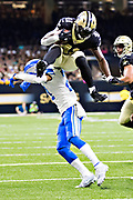 NEW ORLEANS, LA - OCTOBER 15:  Alvin Kamara #41 of the New Orleans Saints jumps over Darius Slay #23 of the Detroit Lions at Mercedes-Benz Superdome on October 15, 2017 in New Orleans, Louisiana.  The Saints defeated the Lions 52-38.  (Photo by Wesley Hitt/Getty Images) *** Local Caption *** Alvin Kamara; Darius Slay