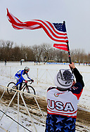 Michael Better, from Washington D.C., waves an American flag to cheer for his country's competitors as Italy's Eva Lechner (23) rides past during the Elite Women's UCI Cyclocross World Championships held at Eva Bandman Park in Louisville, Kentucky, on February 2, 2013. © Dan Henry / BiciPhoto.com