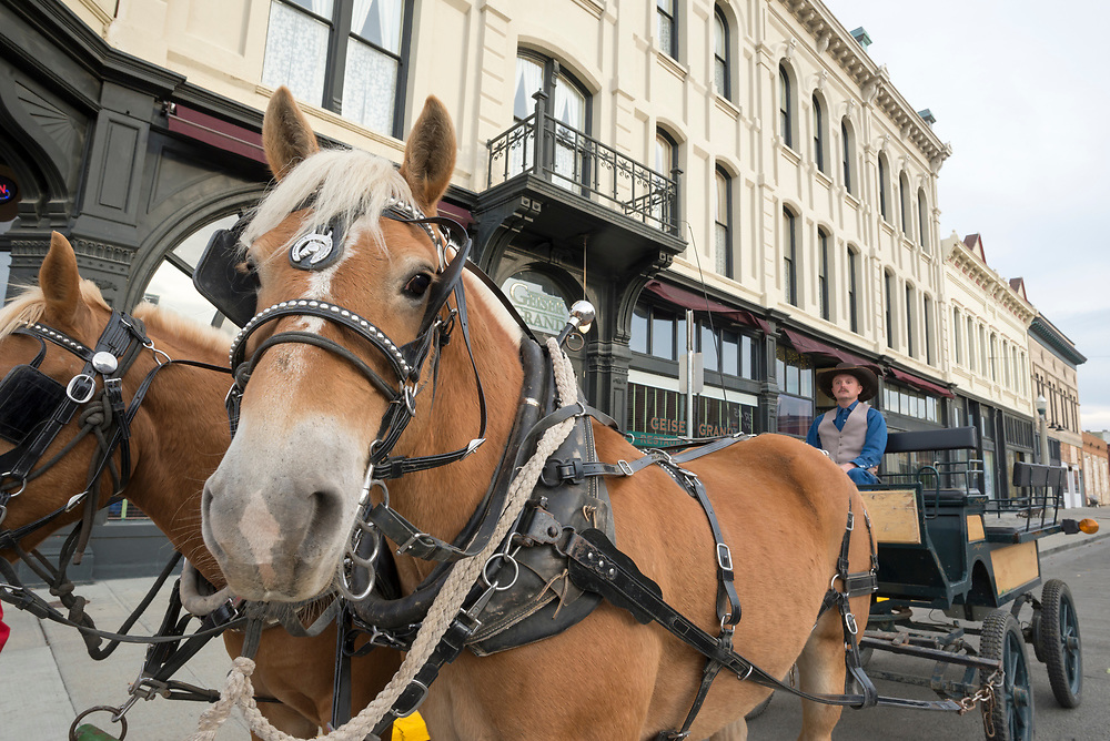 Horse drawn buggy in front of the historic Geiser Grand Hotel in downtown Baker City, Oregon.