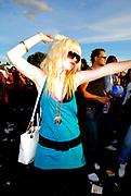 Girl with bleached hair and big black belt dancing, Metro Weekender, Get Loaded In The Park, London 2006