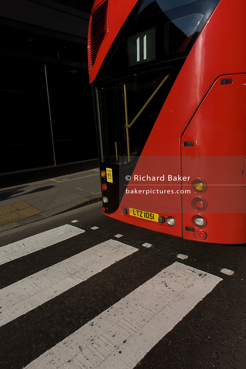 Repetition and visual pun of stripes from zebra crossing and number 11 Routemaster bus.