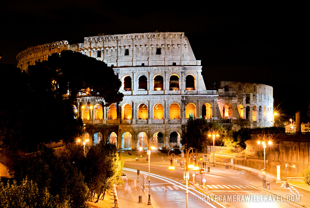 A shot at night of the famous Coliseum of Rome under lights.