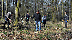 ©London News pictures. 22/03/11. A police officer watches the volunteers whilst they search. Locals and friends of Sian O'Callaghan help Police in the search in Savernake Wood, Wiltshire, today. Detectives continue investigating the disappearance of office administrator Sian O'Callaghan. The 22-year-old disappeared after leaving Suju nightclub in Swindon at about 2.50am on Saturday to walk the half-mile home to the flat she shared with her boyfriend Kevin Reape. Picture Credit should read Stephen Simpson/LNP