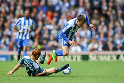 Solly March of Brighton & Hove Albion is tackled by Shaun MacDonald of Wigan Athletic - Mandatory by-line: Jason Brown/JMP - 17/04/2017 - FOOTBALL - Amex Stadium - Brighton, England - Brighton and Hove Albion v Wigan Athletic - Sky Bet Championship