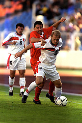 MINSK, BELARUS - Saturday, September 4, 1999: Belarus's Andrei Lavrik and Wales's Dean Saunders during the UEFA Euro 2000 Qalifying Group One match at the Dinamo Stadium. (Mandatory credit: David Rawcliffe/Propaganda)