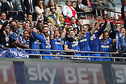 AFC Wimbledon defender Barry Fuller (2) lifts the trophy  celebrates promotion to Sky Bet League 1 at the end ofduring the Sky Bet League 2 play off final match between AFC Wimbledon and Plymouth Argyle at Wembley Stadium, London, England on 30 May 2016.