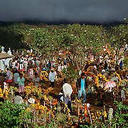 Members of the Mixteco indigenous community of Metlatonoc gather at the cemetary on the first morning of celebrations of the holiday Dia De Los Muertos, or Day Of The Dead, on November 1, 2003. Photo by Jen Klewitz