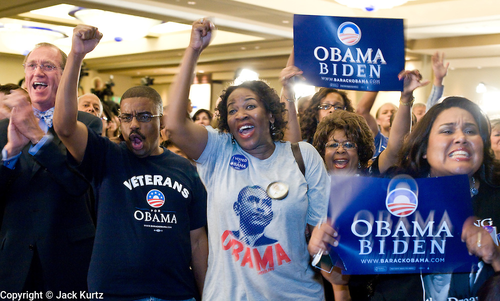 04 NOVEMBER 2008 -- PHOENIX, AZ: Terry Hanson (CQ FAR LEFT), Larry Simpson (CQ) his wife, Elaine Simpson (CQ) from Mesa, and Bridgette Chavez (CQ) from central Phoenix cheer for Barack Obama during his victory at the Democratic party's election watch party at the Wyndham Hotel in Phoenix.  PHOTO BY JACK KURTZ