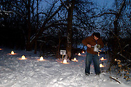Emmet Roth of Centerville helps light the candles before the Holiday stroll and luminaria walk from Forest Field Park, through the meadows of Bill Yeck Park to the historic Smith home, part of the Centerville-Washington Township Park District, Friday, December 17, 2010.  Roth has been volunteering with the Park District for 12 years.