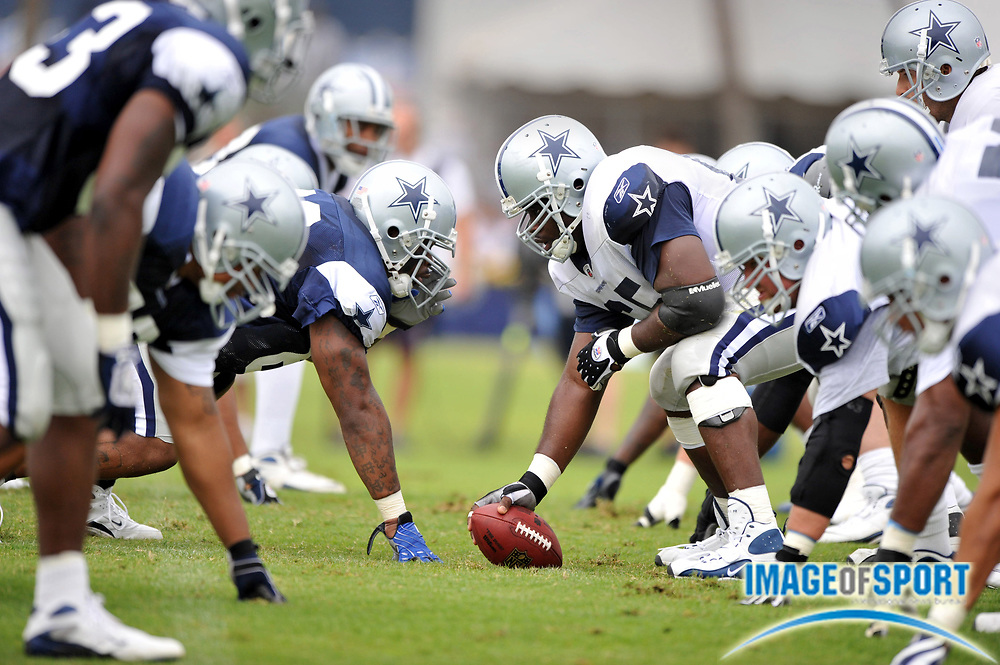 Jul 28, 2008; Oxnard, CA, USA; Dallas Cowboys center Andre Gurode (65) snaps ball to quarterback Tony Romo (9) at the line of scrimmage at training camp at River Ridge Field at Residence Inn by Marriott. Mandatory Credit: Kirby Lee/Image of Sport-US PRESSWIRE