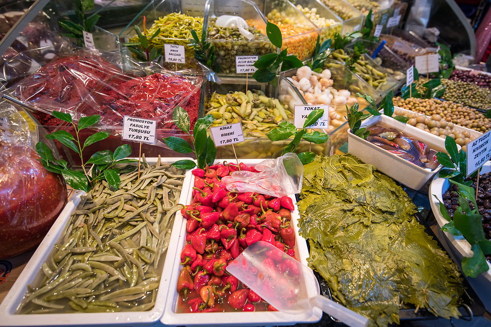 Bin contain a variety of pickled vegetables available for purchase at Istanbul Spice bazaar in Turkey