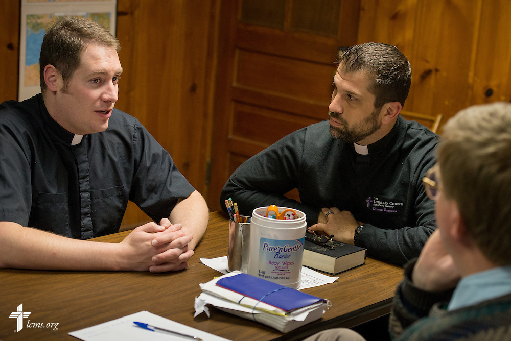 Rev. Michael W. Meyer, manager of LCMS Disaster Response (left) and Rev. Ross E. Johnson, director of LCMS Disaster Response (center, right), talk with Rev. Timothy Mueller of Saint John Lutheran Church during a meeting in New Minden, Ill., on Wednesday, Dec. 18, 2013. The tornado that damaged the church and surrounding homes in November was one among nearly two dozen that swept through the state, killing a total of seven. LCMS Communications/Erik M. Lunsford