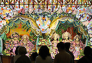 WATFORD HERTFORDSHIRE: Guests stand infront of a deity. Over 55,000 pilgrims and guests visit the Largest Hindu Festival in Europe at Bhaktivedanta Manor Krishna Temple near Watford on Sunday 5th September to celebrate Janmashtami the birth of Lord Krishna. The Manor was donated to the Hare Krishna Movement in the early 1970s by former Beatle George Harrison. 03 SEPT 2010. STEPHEN SIMPSON ..