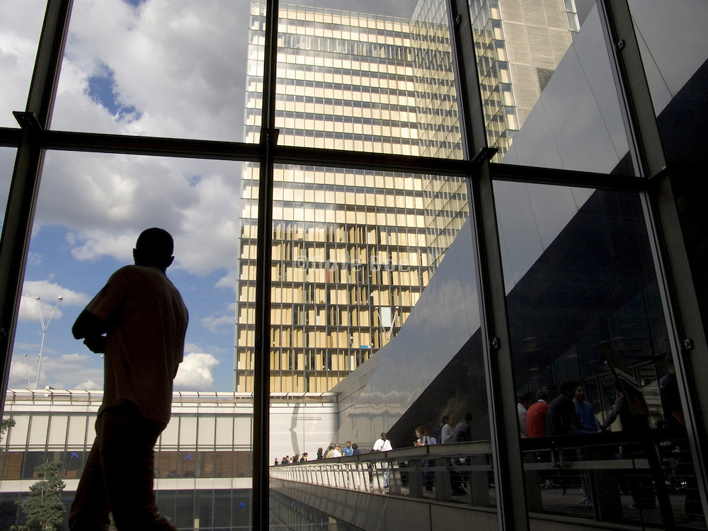 student looking out Bibliotheque Nationale de France Paris