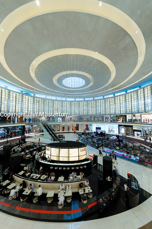 Interior of large atrium at Fashion avenuse with cafes and shops at Dubai Mall in Dubai United Arab Emirates