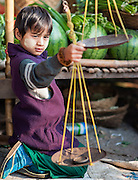 Burmese boy with scale at local market in Kalaw (Myanmar)