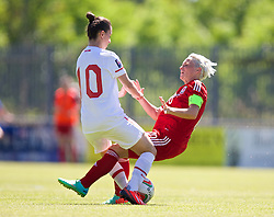 HAVERFORDWEST, WALES - Saturday, June 14, 2014: Wales' captain Jessica Fishlock and Turkey's Fatima Kara during the FIFA Women's World Cup Canada 2015 Qualifying Group 6 match at the Bridge Meadow Stadium. (Pic by David Rawcliffe/Propaganda)