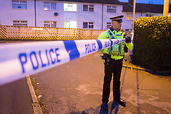 © Licensed to London News Pictures. 19/01/2017. Ovenden UK. Picture shows police outside a property on Athol Close in Ovenden near Halifax this morning, Police were called to Athol Close following reports a man had been attacked, a man was found with serious injuries & was treated by paramedics but died at the scene. Detectives have launched a murder investigation & two men aged 33 & 25 have been arrested on suspicion of murder. Photo credit: Andrew McCaren/LNP