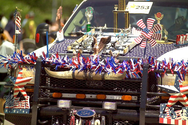 Stock photo of a patriotic truck with red, white, and blue decor of all kinds.