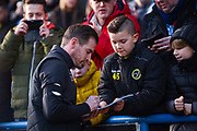 Jan Siewert of Huddersfield Town (Manager) signs autographs for young fans before the Premier League match between Huddersfield Town and Arsenal at the John Smiths Stadium, Huddersfield, England on 9 February 2019.